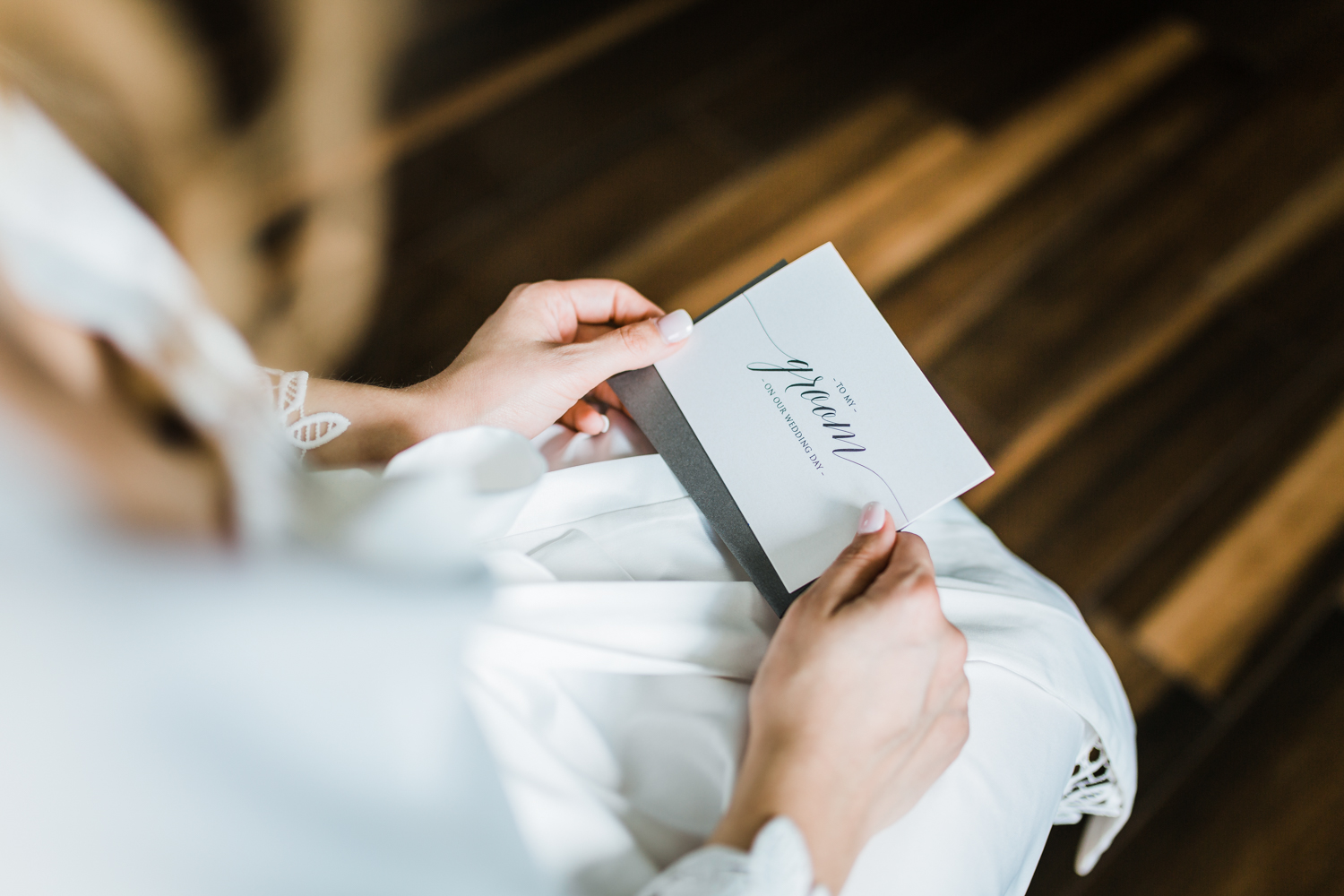 bride reading her letter to her groom - Maryland wedding film - top rated md wedding cinematography / videography
