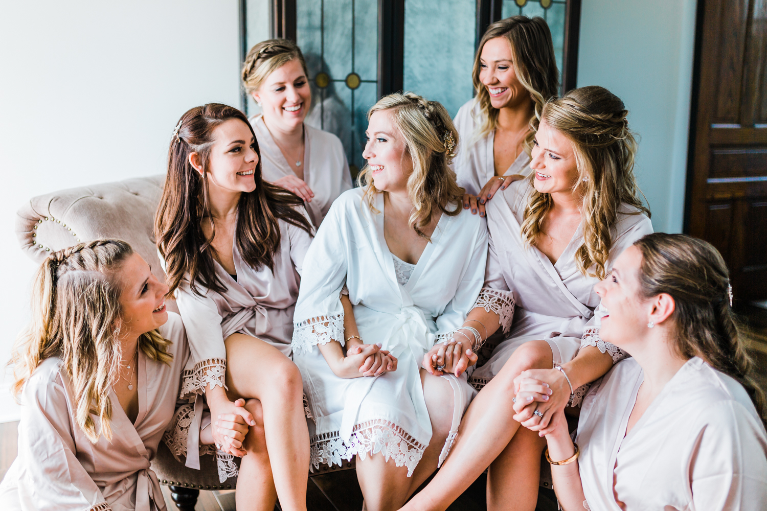 Bride laughing with her bridesmaids in Pond View Farm's bridal suite