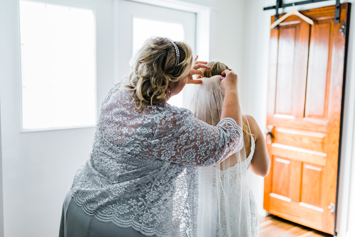 Bride's Mom putting on her veil - 5 star wedding photo and video in Maryland