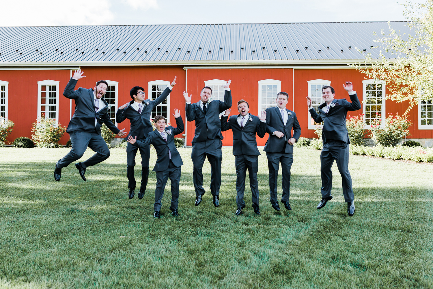 Funny jumping groomsmen - Rustic Maryland Wedding Venue