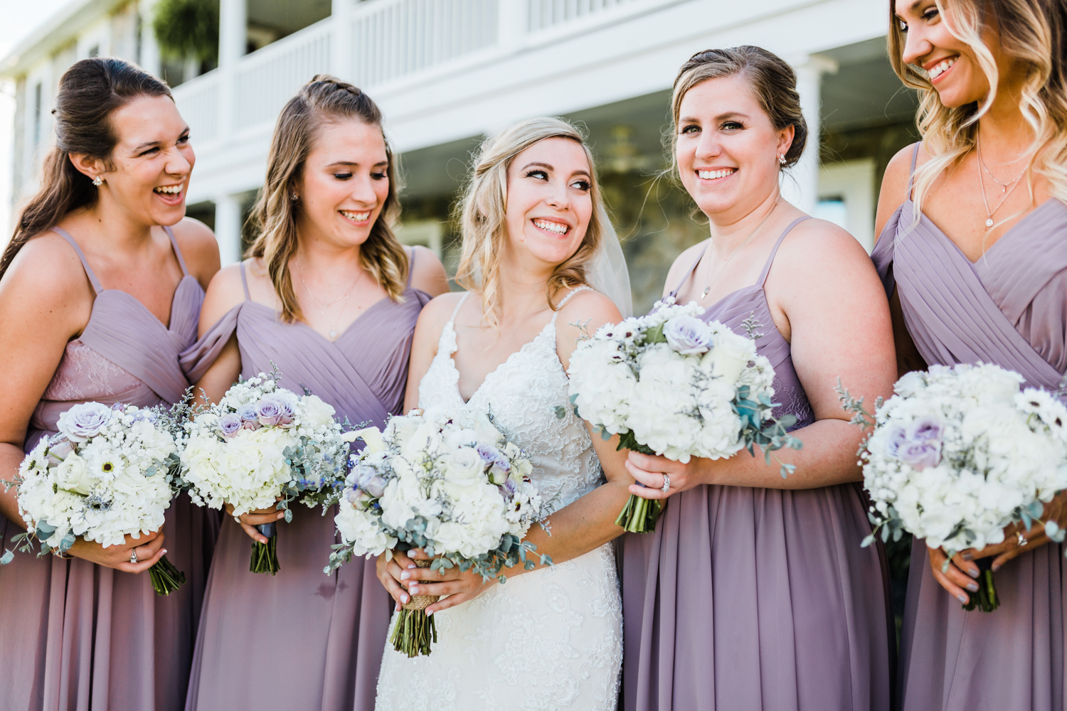 Bride with laughing with bridesmaids - MD best photographer in Maryland