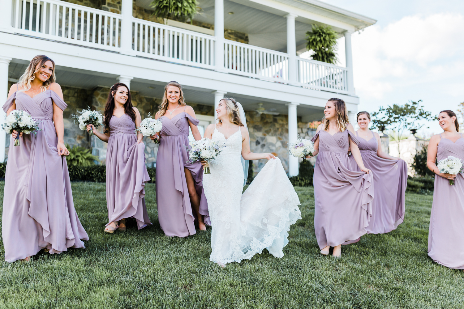 Bride walking and laughing with bridesmaids - Maryland