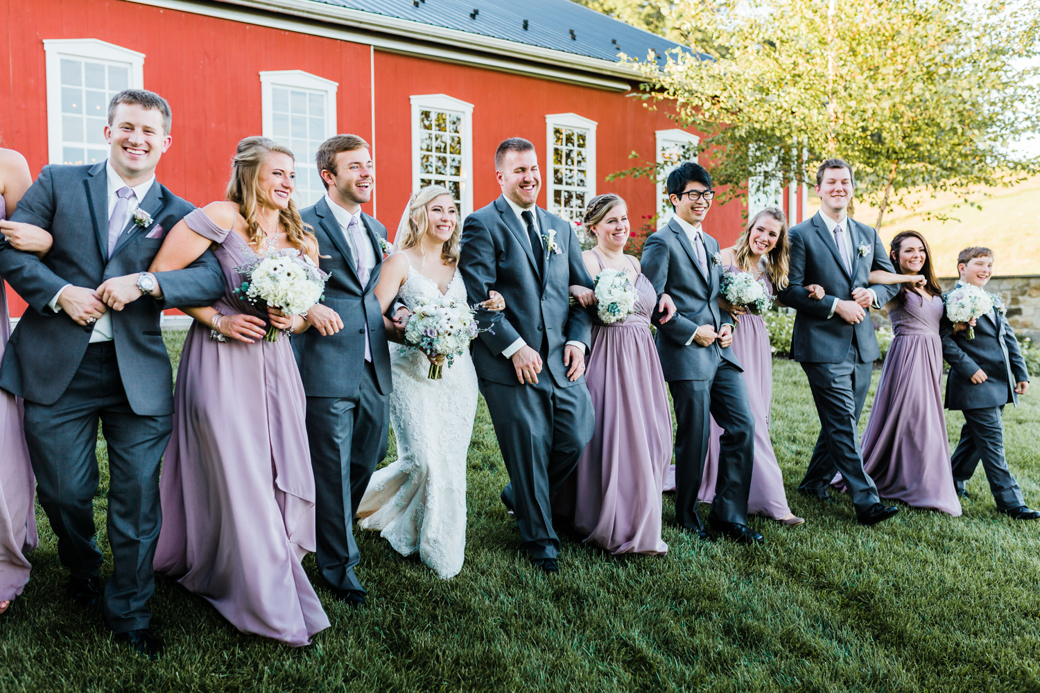 Bridal party walking with bride and groom - Rustic Maryland venue