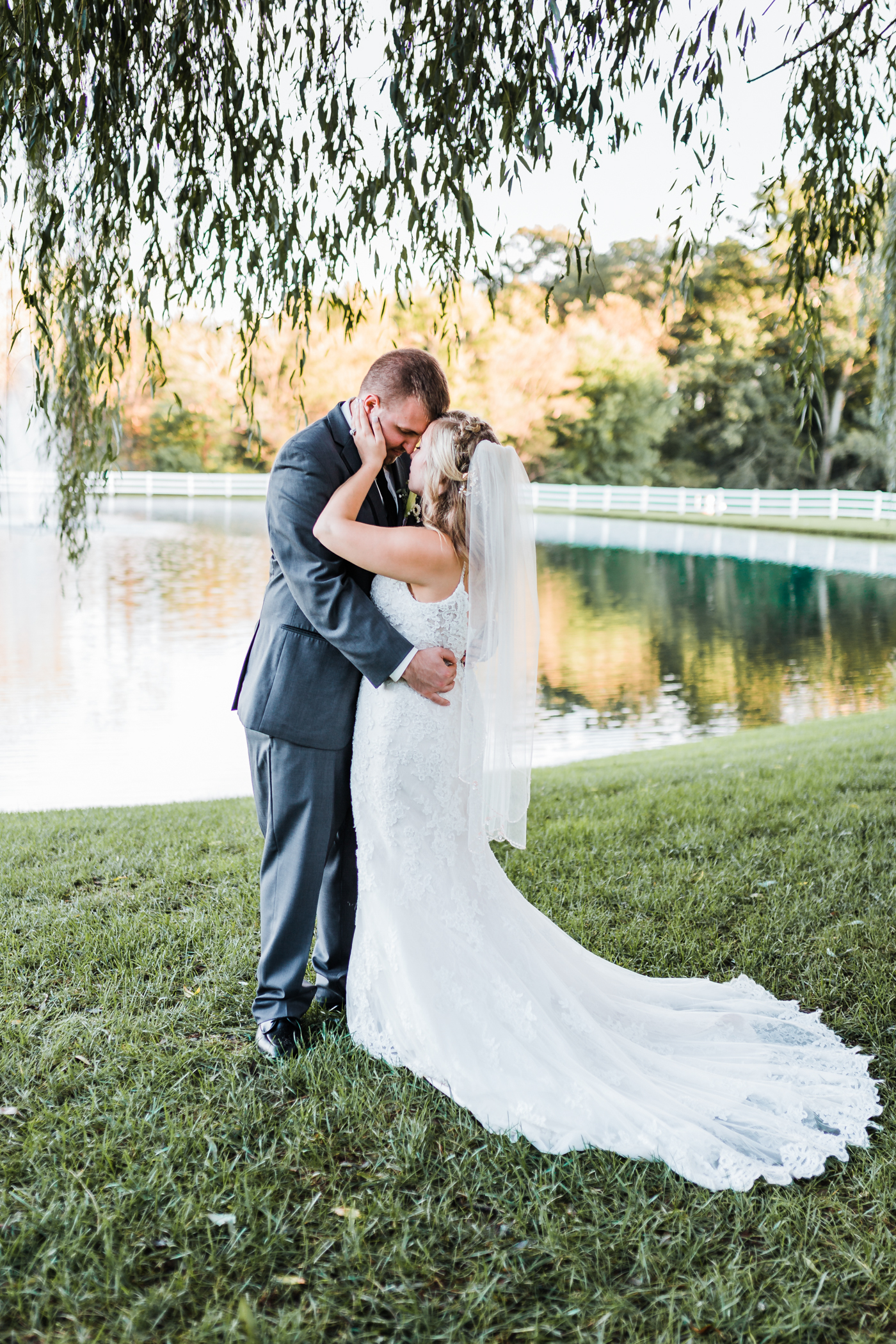 Romantic portrait of Bride and Groom by pond - Top rated MD photographer