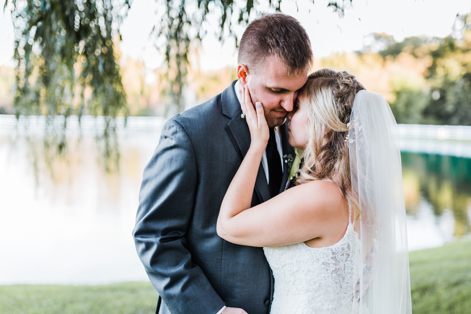Couple hugs by willow tree - Maryland wedding video