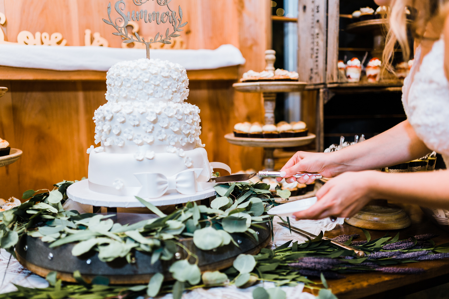 Bride and Groom cut their cake - wedding cake inspo
