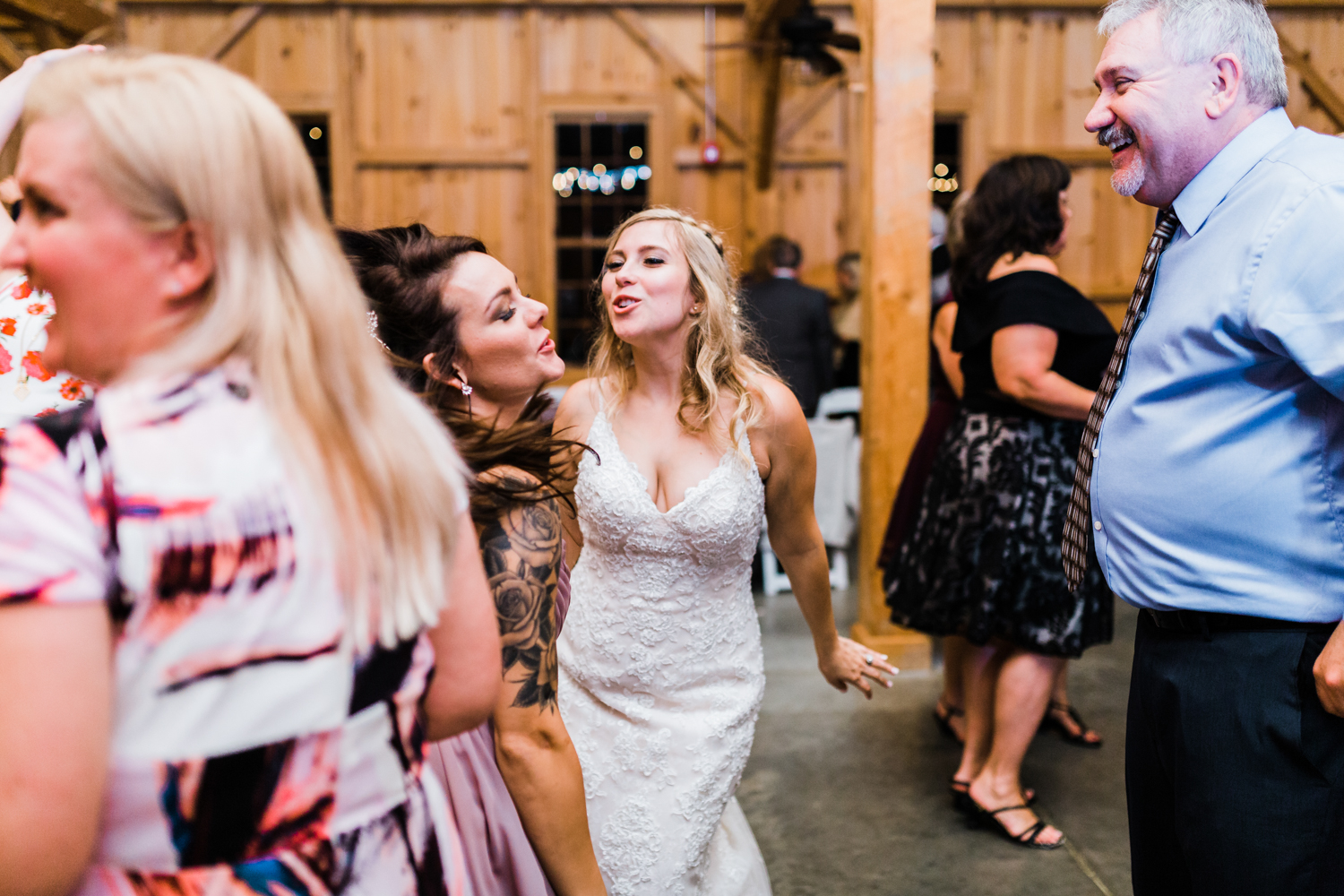 bride dancing with her best friend at Pond View Farm