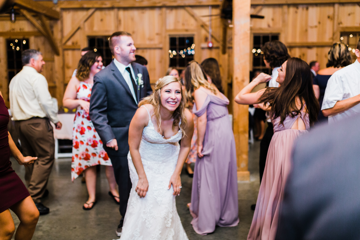 bride laughing during reception at Pond View Farm - best MD wedding photographer and videographer