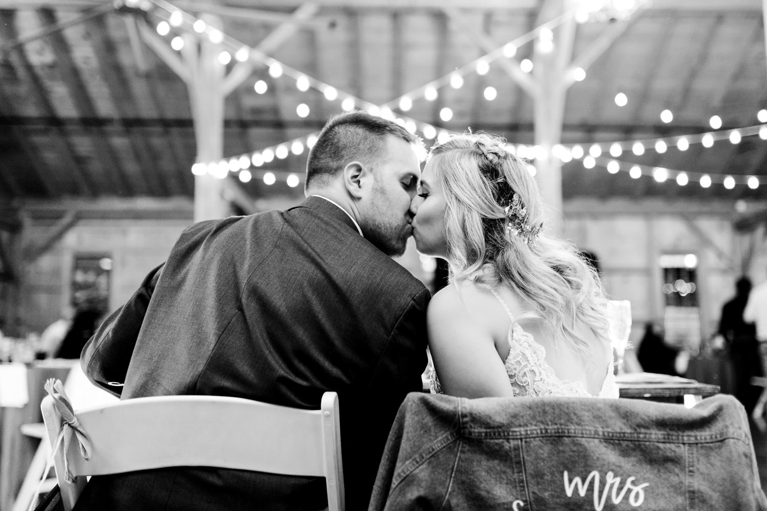 bride and groom kissing at their reception - best Maryland wedding photographer