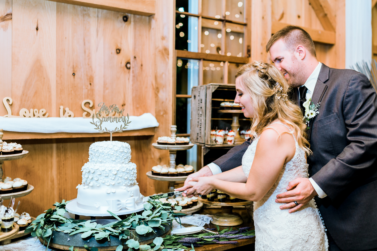 bride and groom cutting their cake at Pond View Farm - Maryland wedding photo and film