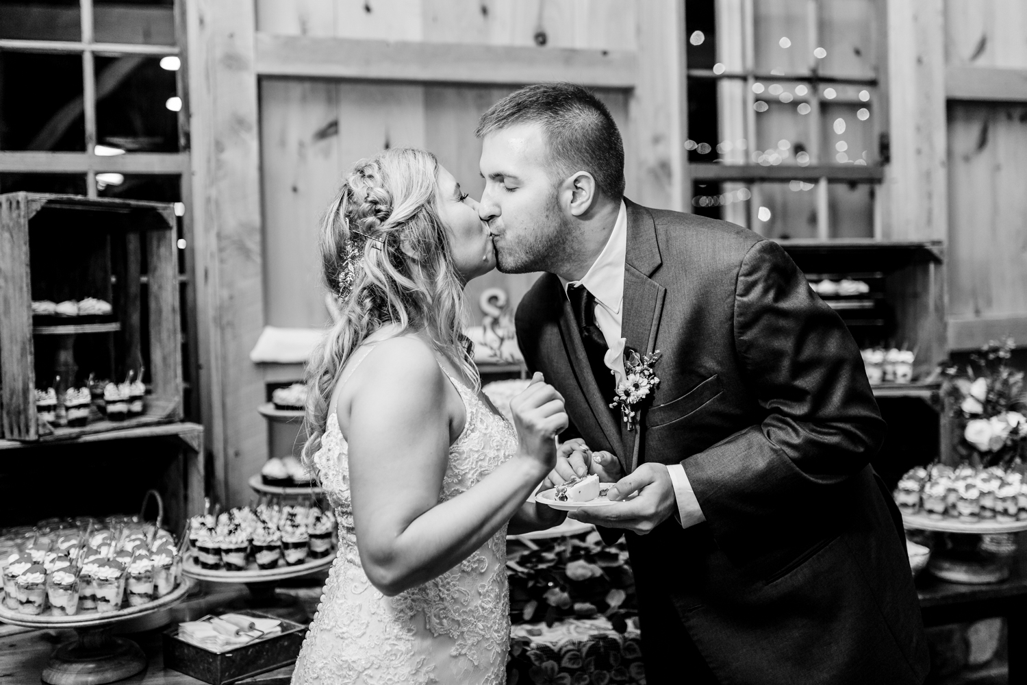 bride and groom kiss after their cake cutting - Maryland wedding photographer and cinematographer