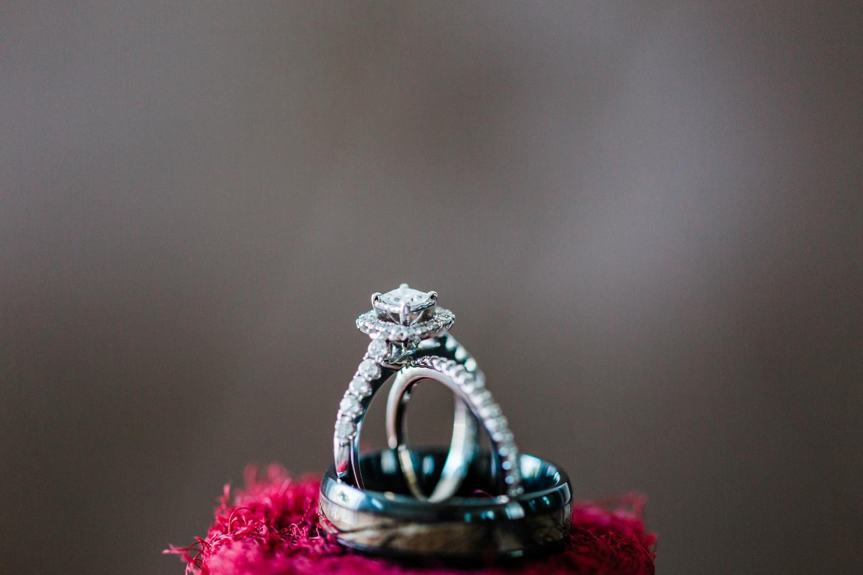 Detail shot of bride and groom rings