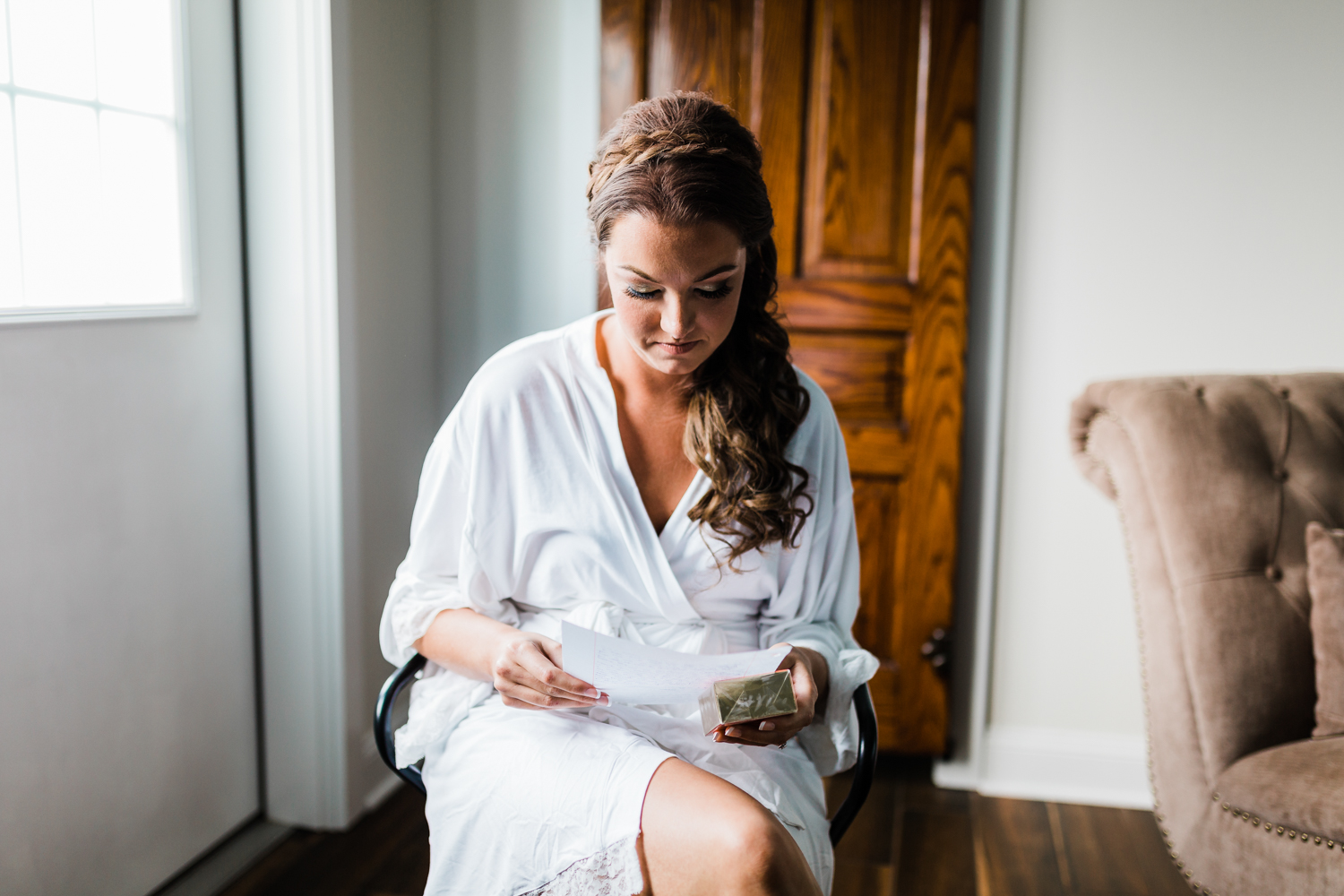 Bride reading letter from groom - best photographer in Maryland