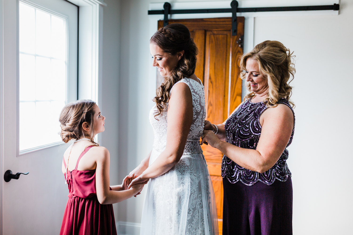 Mother and daughter help bride get ready - top cinematographer in MD
