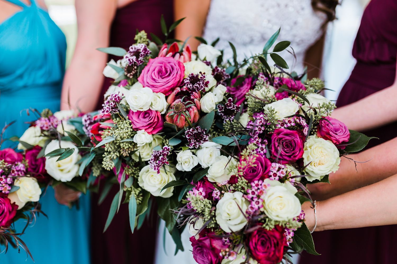 pink, red, white, and green wedding bouquets in Maryland - DMV wedding photo and video