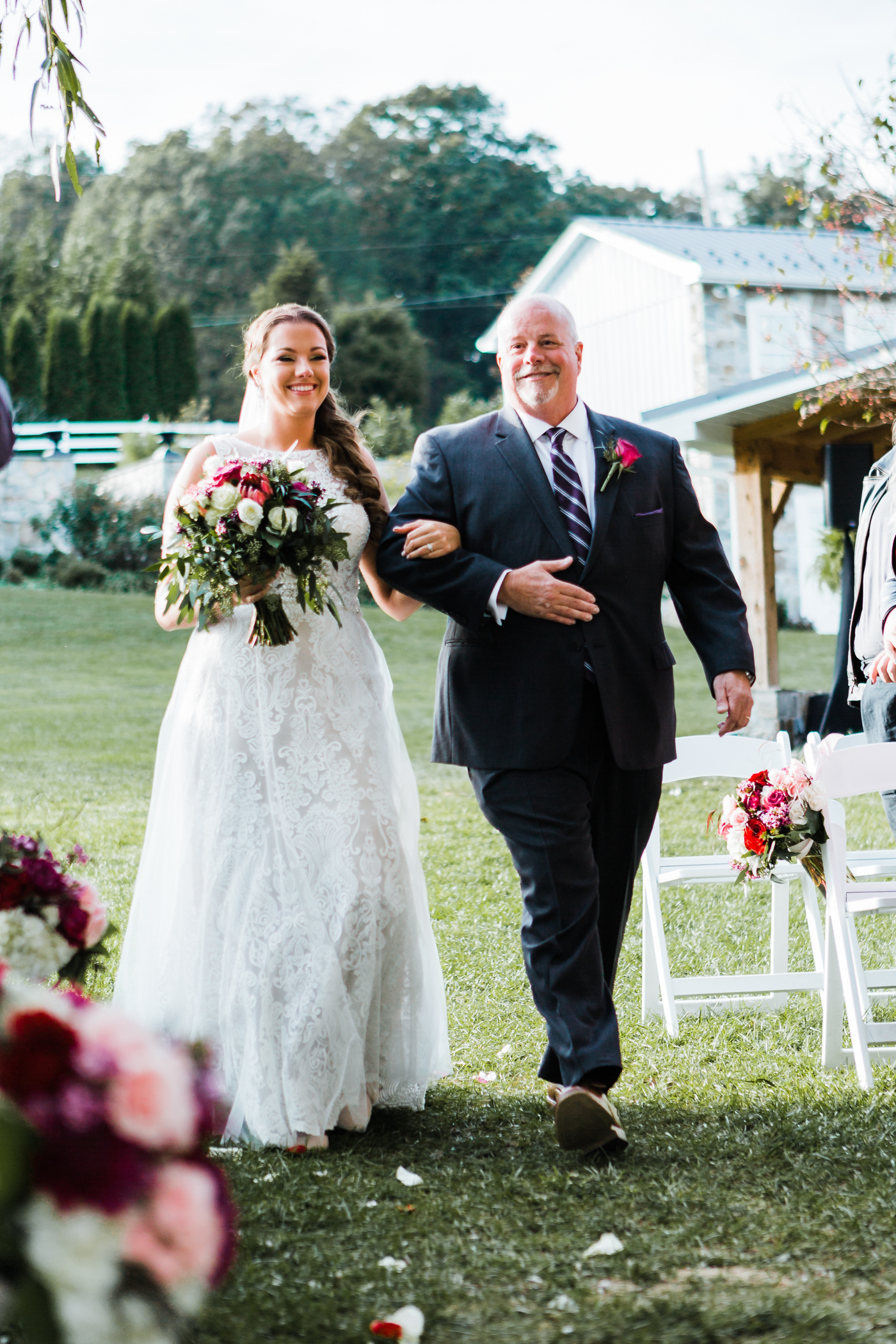 Bride walking down the aisle with her father at Pond View Farm