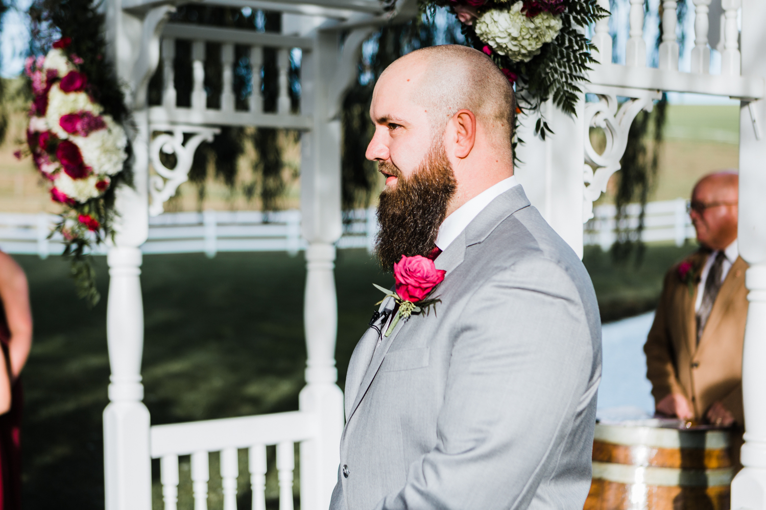 ceremony at Pond View Farm - groom watching his bride walk down the aisle - summer weddings in Maryland