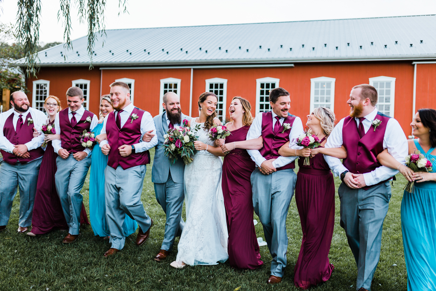 Bride and Groom walking and laughing with their bridal party - Pond View Farm in White Hall, MD