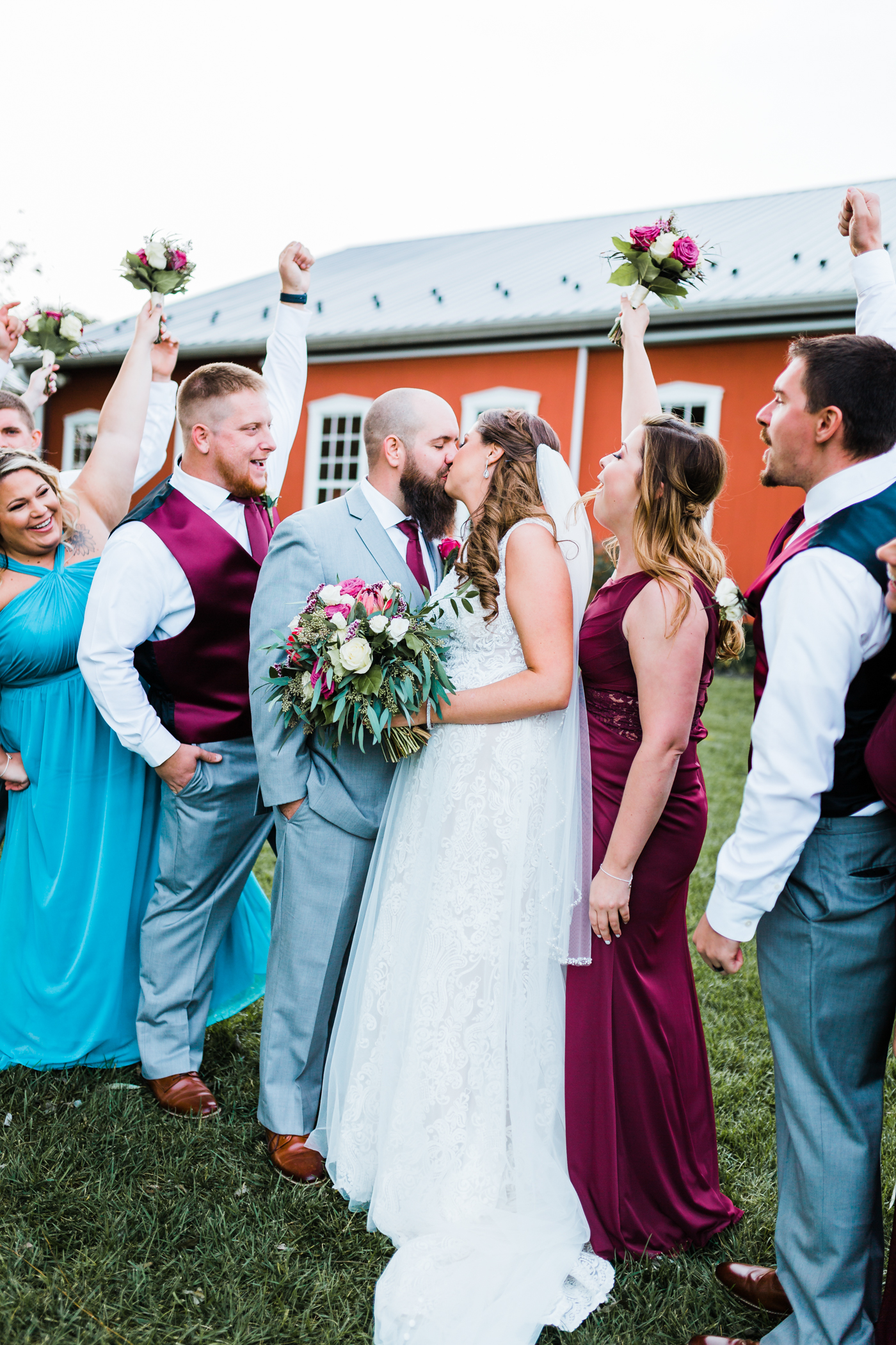 Bridal party cheers while bride and groom kiss - Maryland wedding photo and video