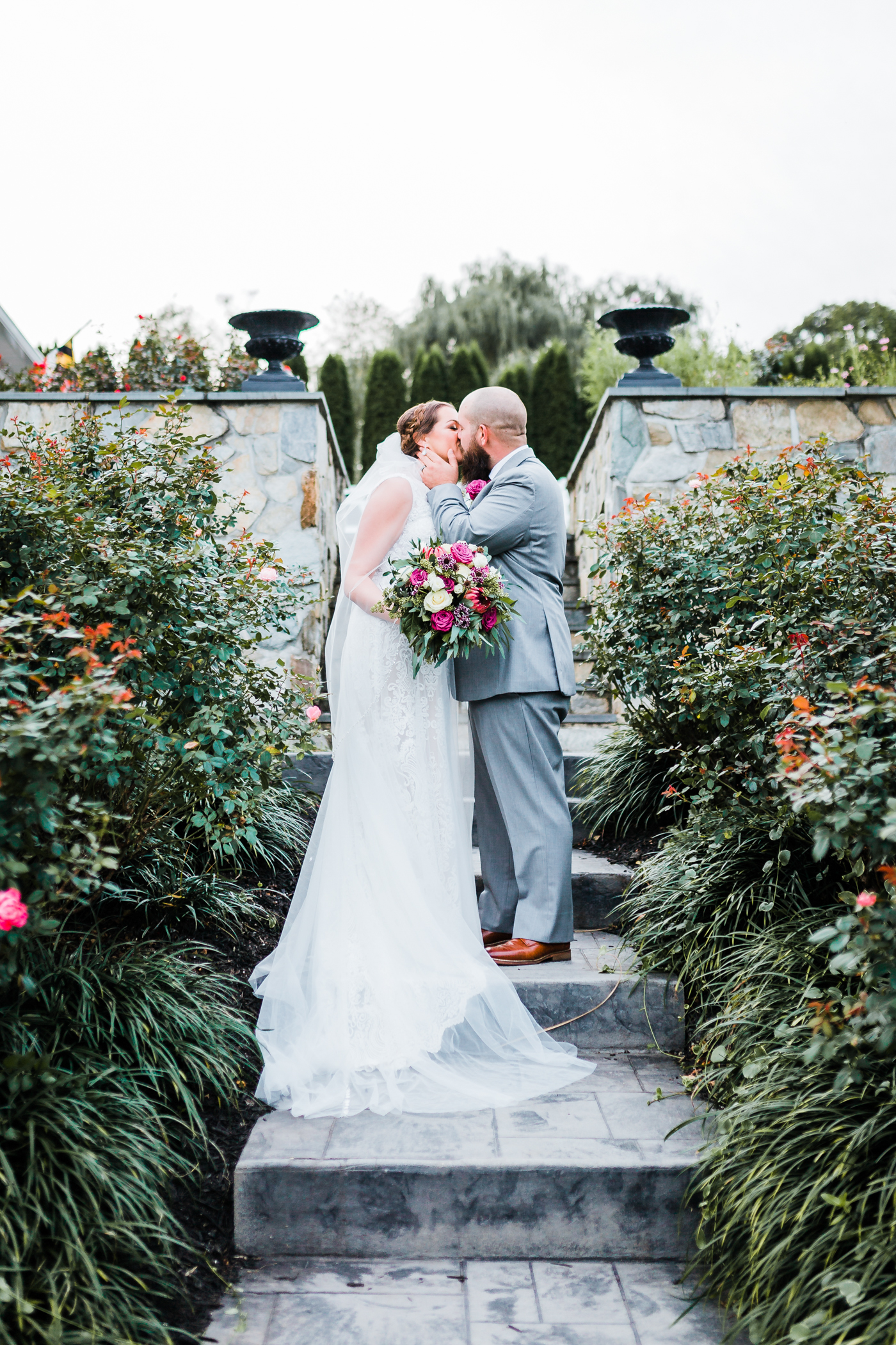 bride and groom kiss at MD wedding venue