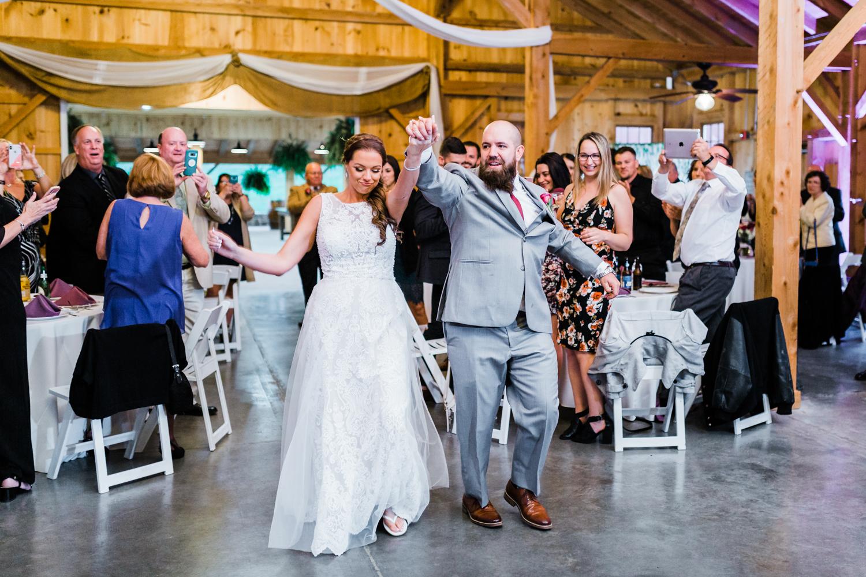 Bride and groom get introduced into reception