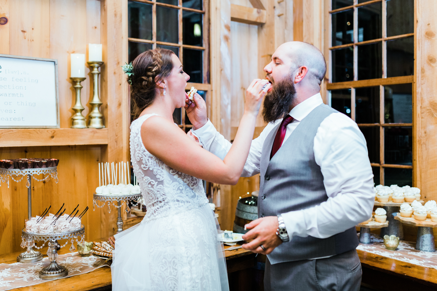 Highly rated photography business in DMV area - bride and groom feed cake to each other