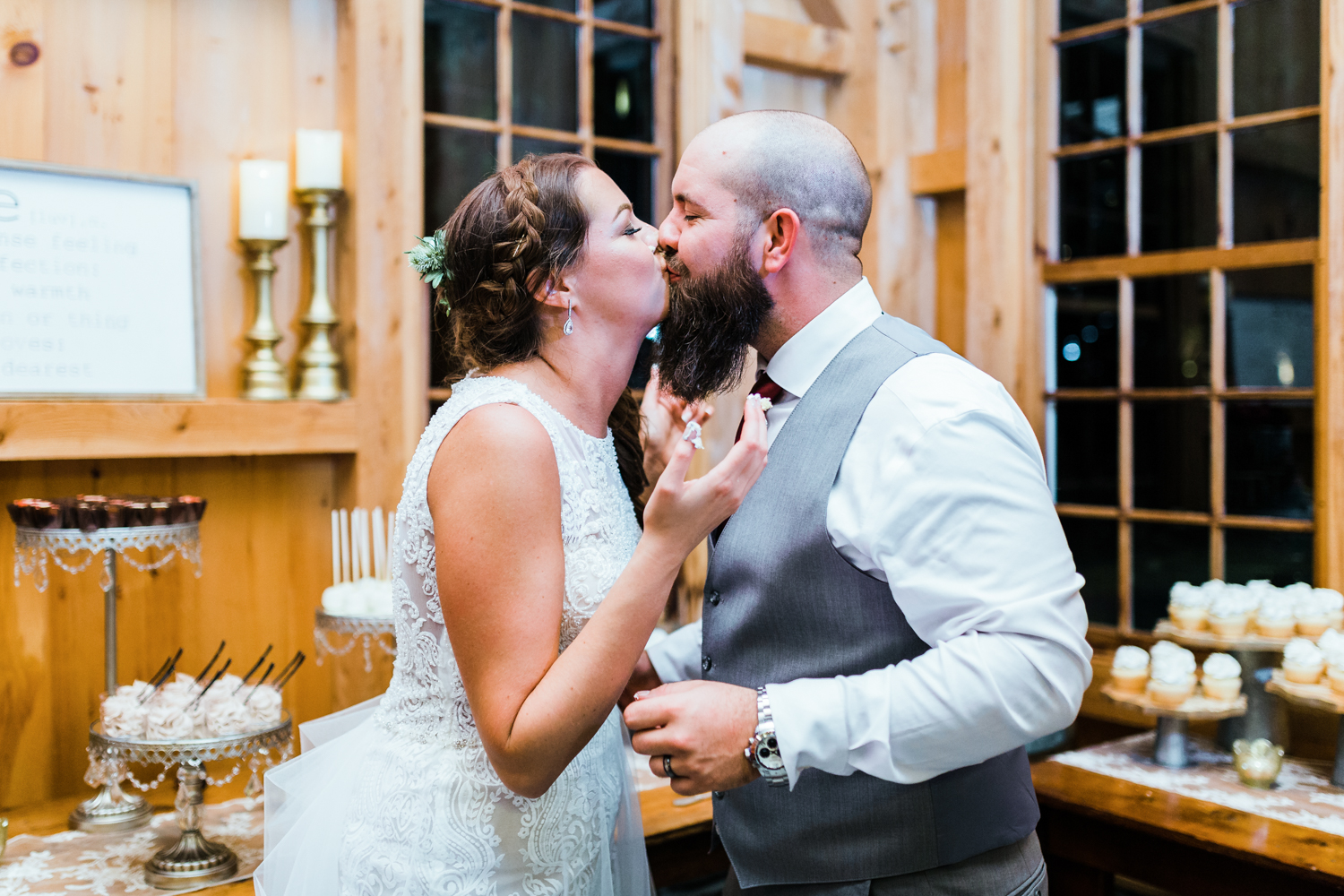 Top rated husband and wife photography team in MD - Bride kissing groom after cake smash