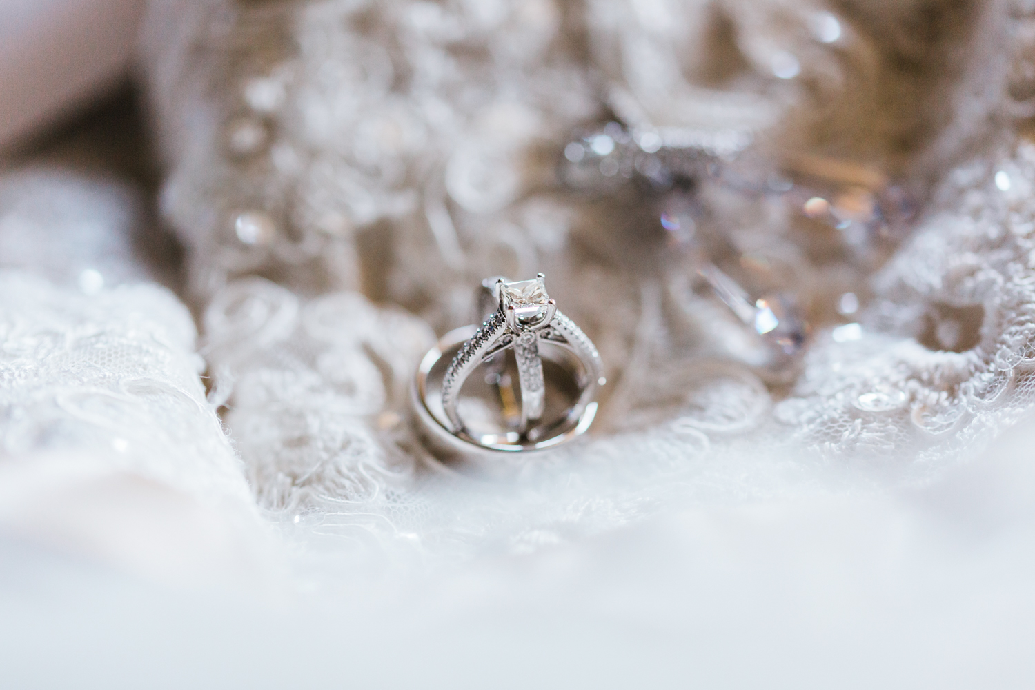 bride and groom wedding rings - top rated husband wife photography team in Maryland