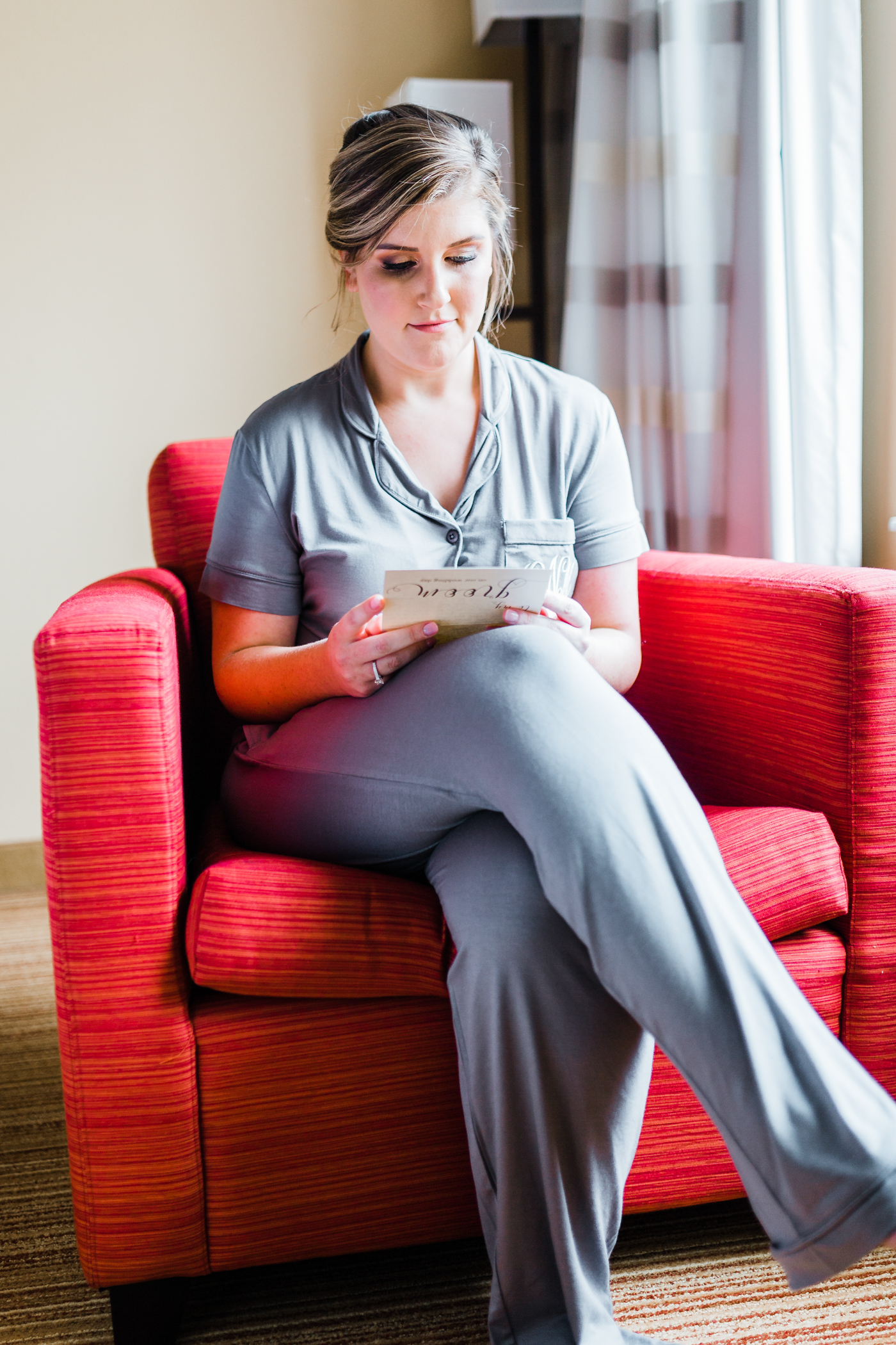 bride reading her letter to her groom for her wedding video - top rated MD wedding photographer and cinematographer