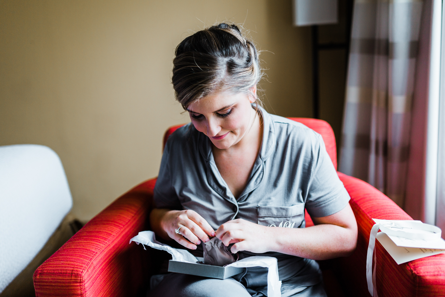 bride opens a gift from her groom - Frederick Maryland wedding venues