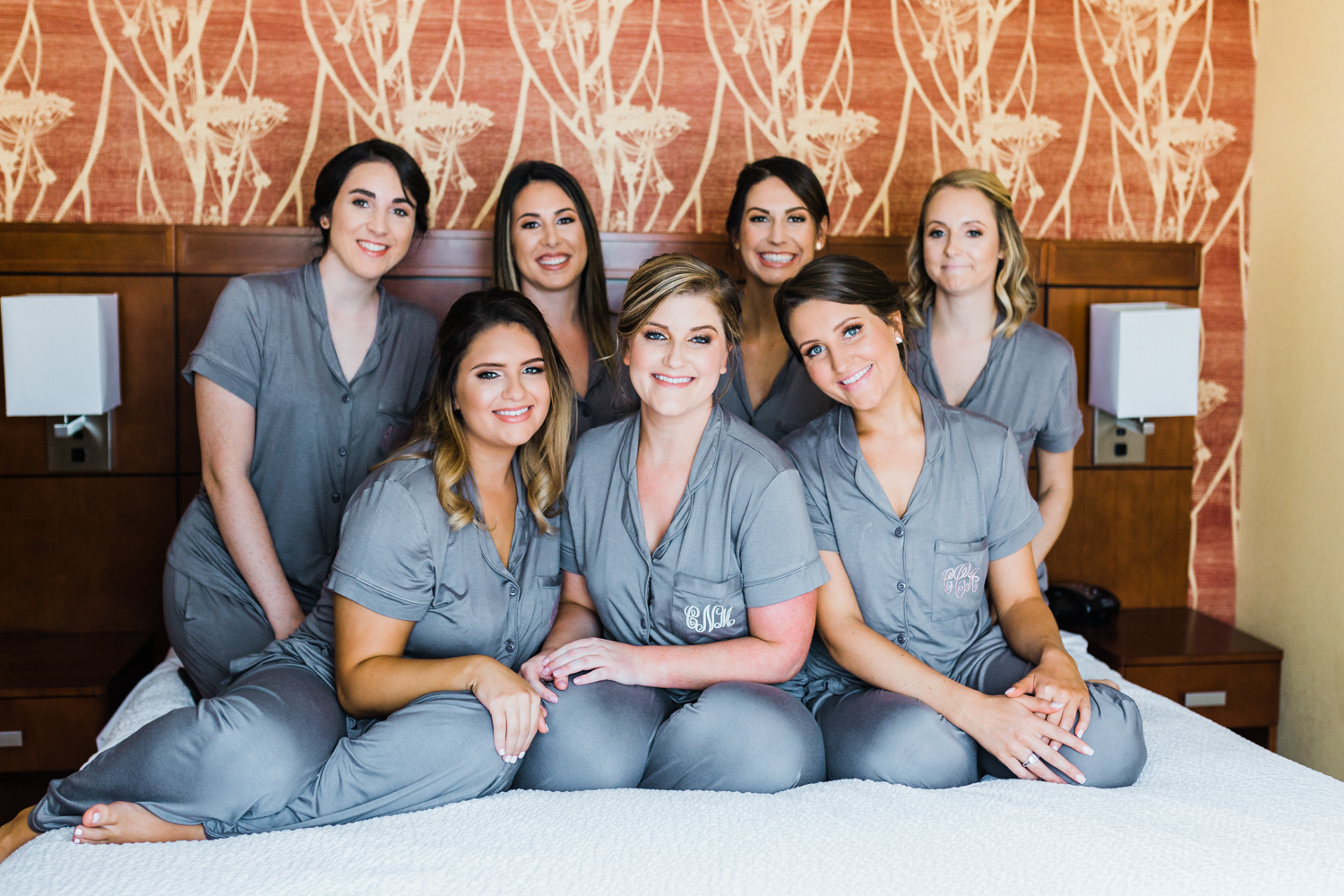 bride and her bridesmaids with matching monogrammed pajamas - Maryland wedding venues - Frederick MD wedding photographer and videographer