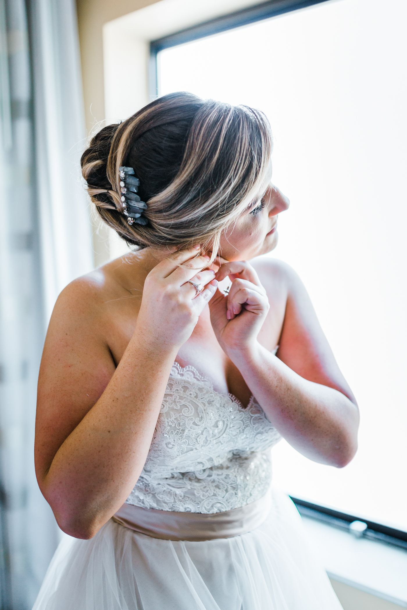 bride putting her earrings on - Frederick Maryland weddings in the Fall