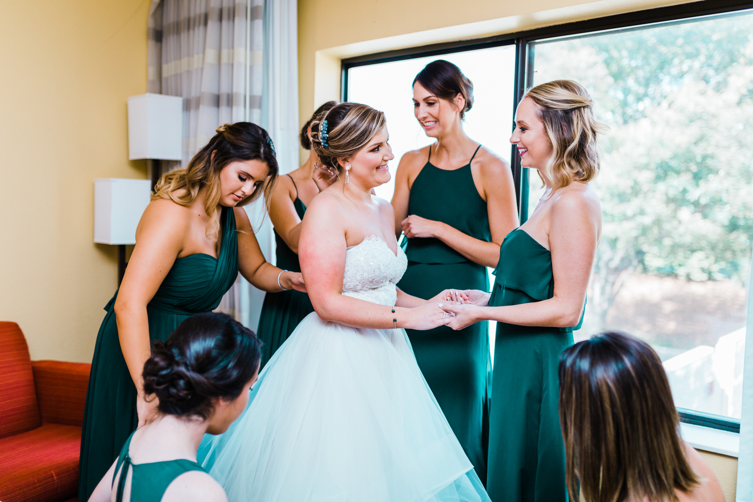 bride getting ready with her bridesmaids - emerald wedding inspiration - green bridesmaids dresses