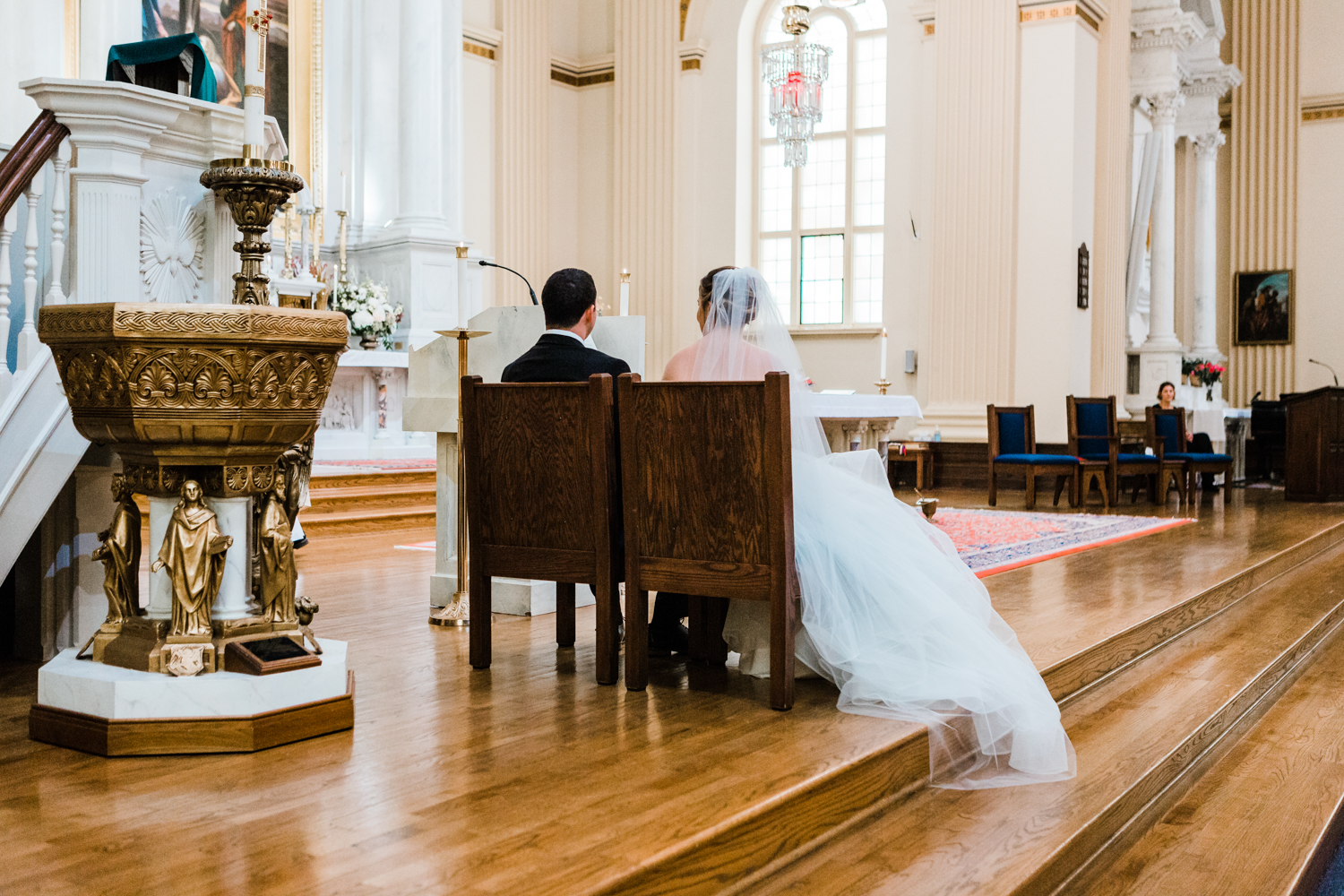 couple sitting together during their wedding ceremony
