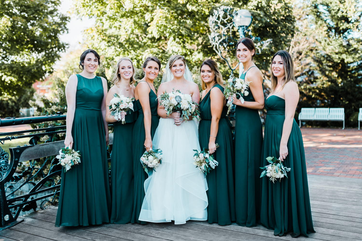 bride with her bridesmaids on bridge in Frederick Maryland - green wedding inspiration