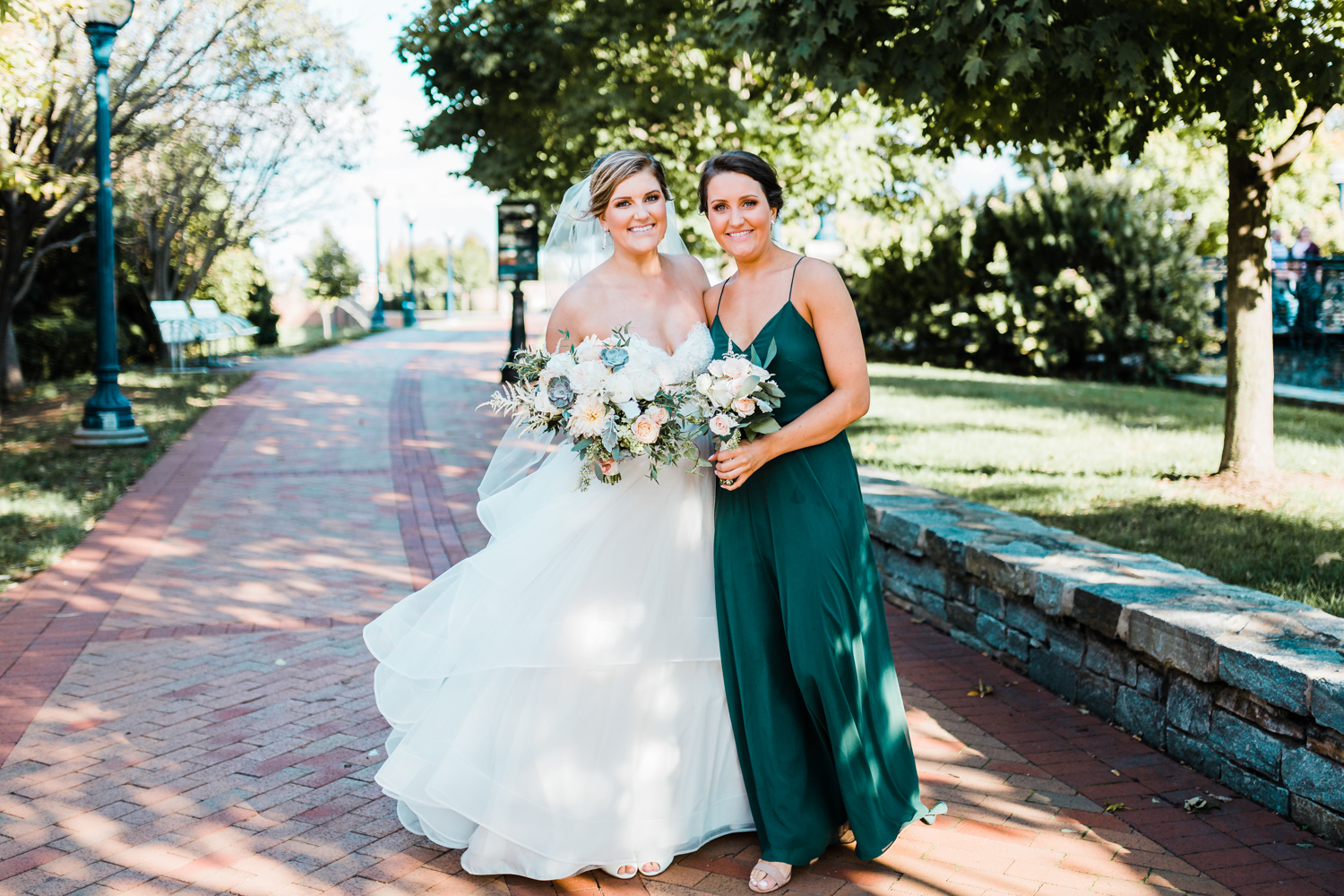 bride with her sister - Frederick MD wedding day in the Fall McClintock Distilling