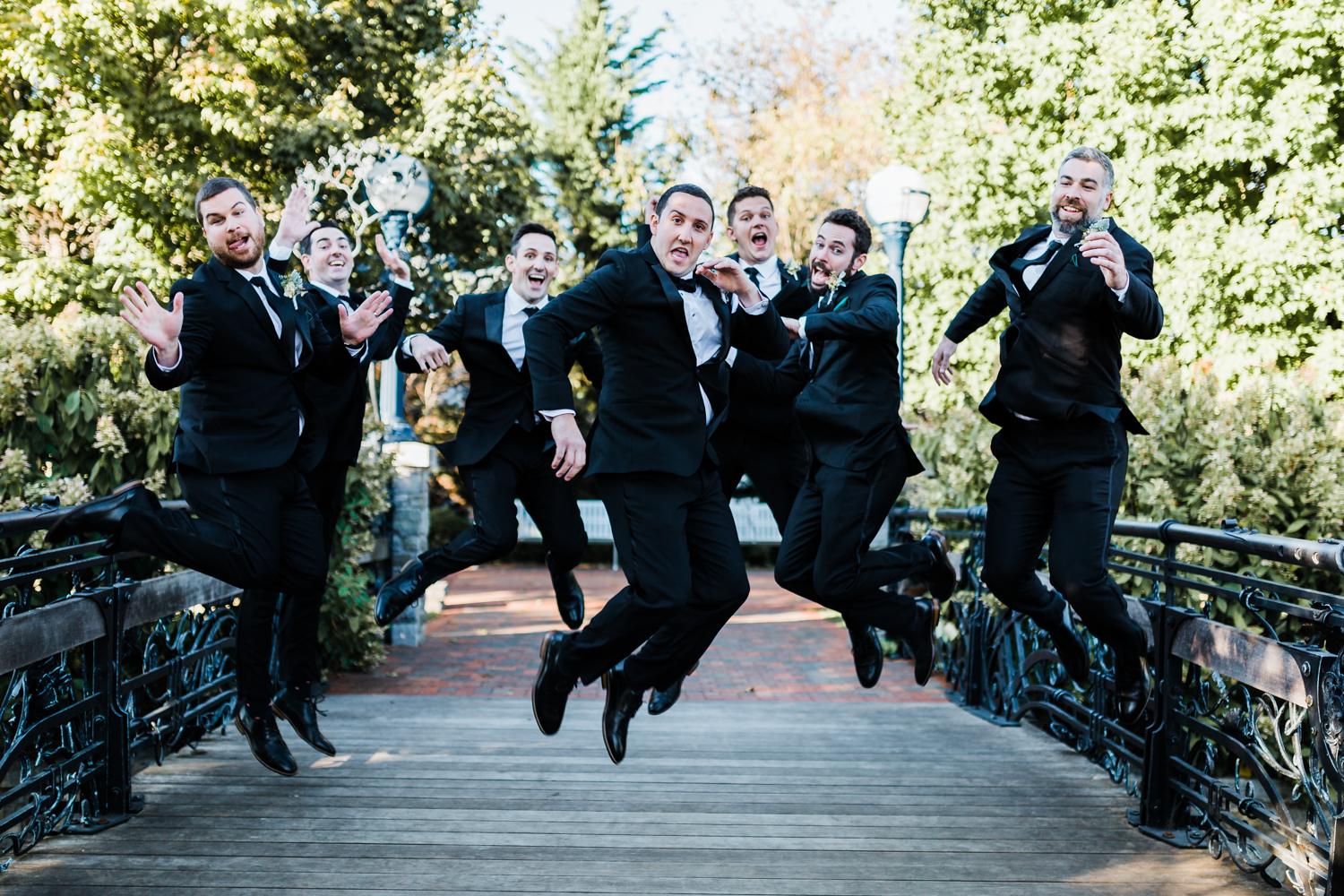 fun shots to do with your groomsmen on your wedding day - groom and groomsmen jumping - best Maryland wedding photographers