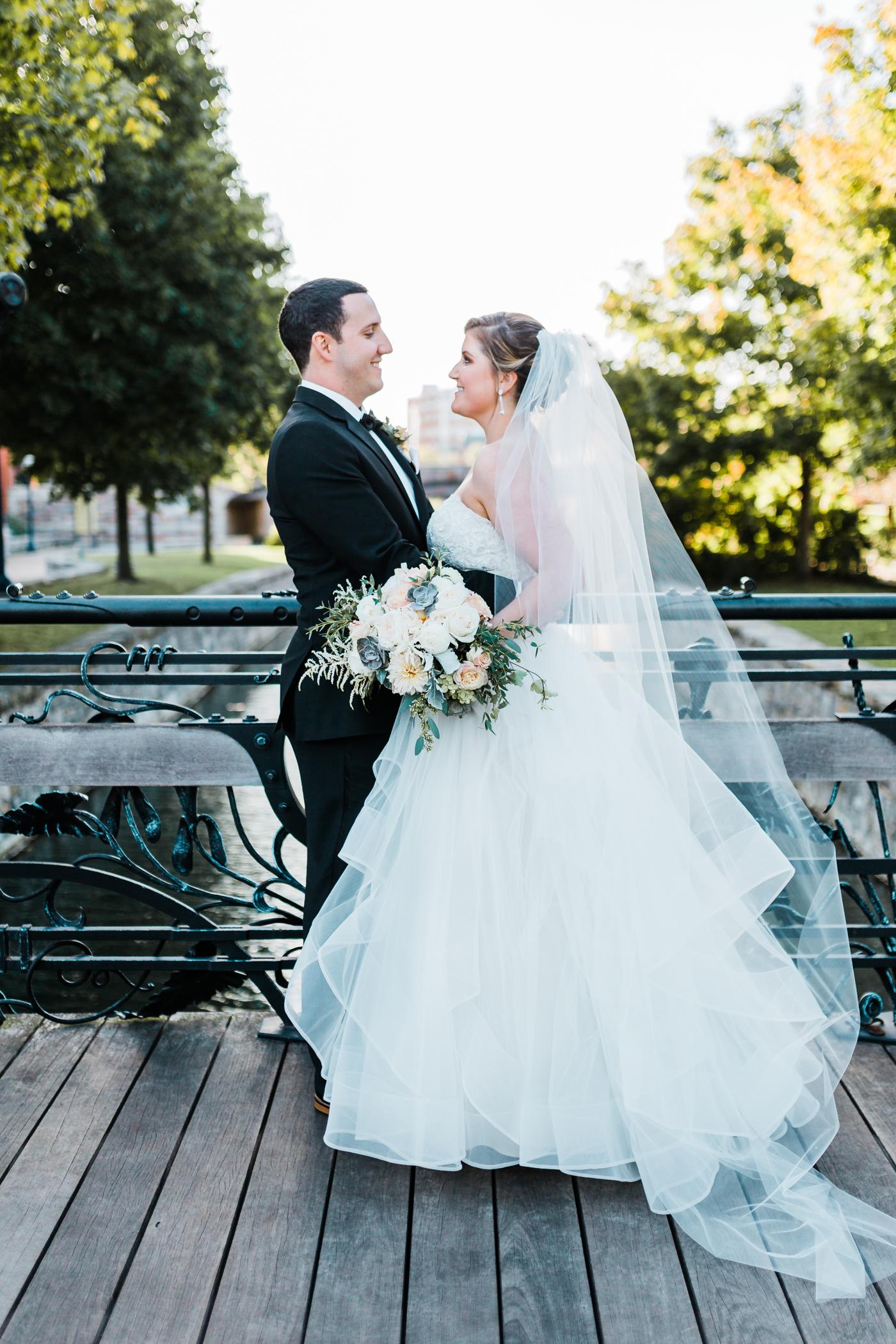 Maryland wedding bride and groom on bridge - unique wedding dress designs - modern wedding venues in Maryland