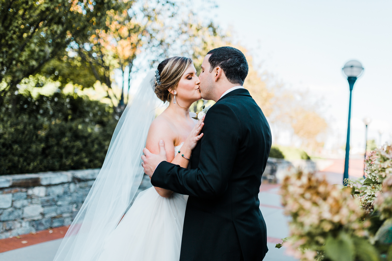 bride and groom kiss with the gorgeous fall golden hour light in Frederick, Maryland