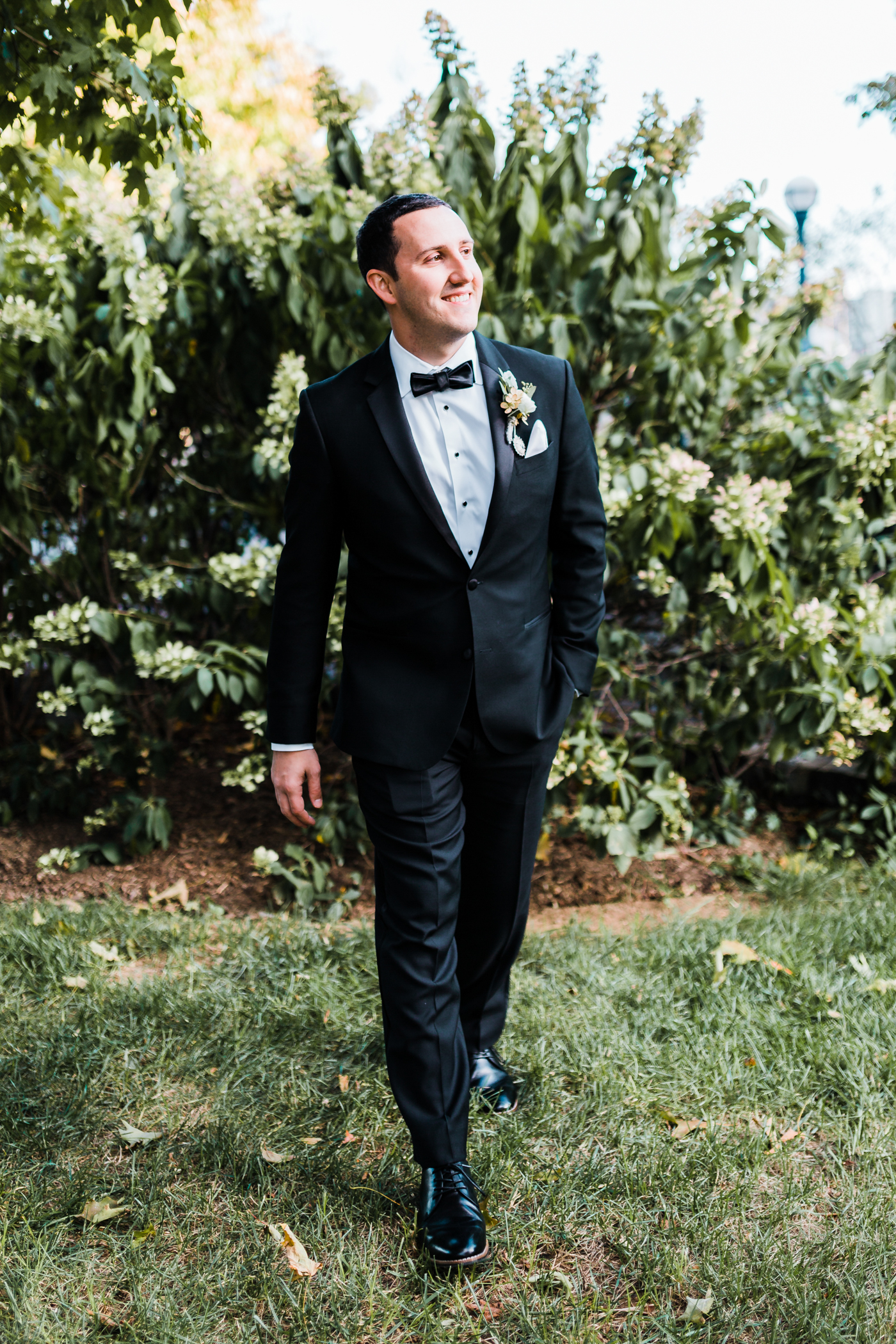 handsome groom in a black tuxedo in Frederick, MD