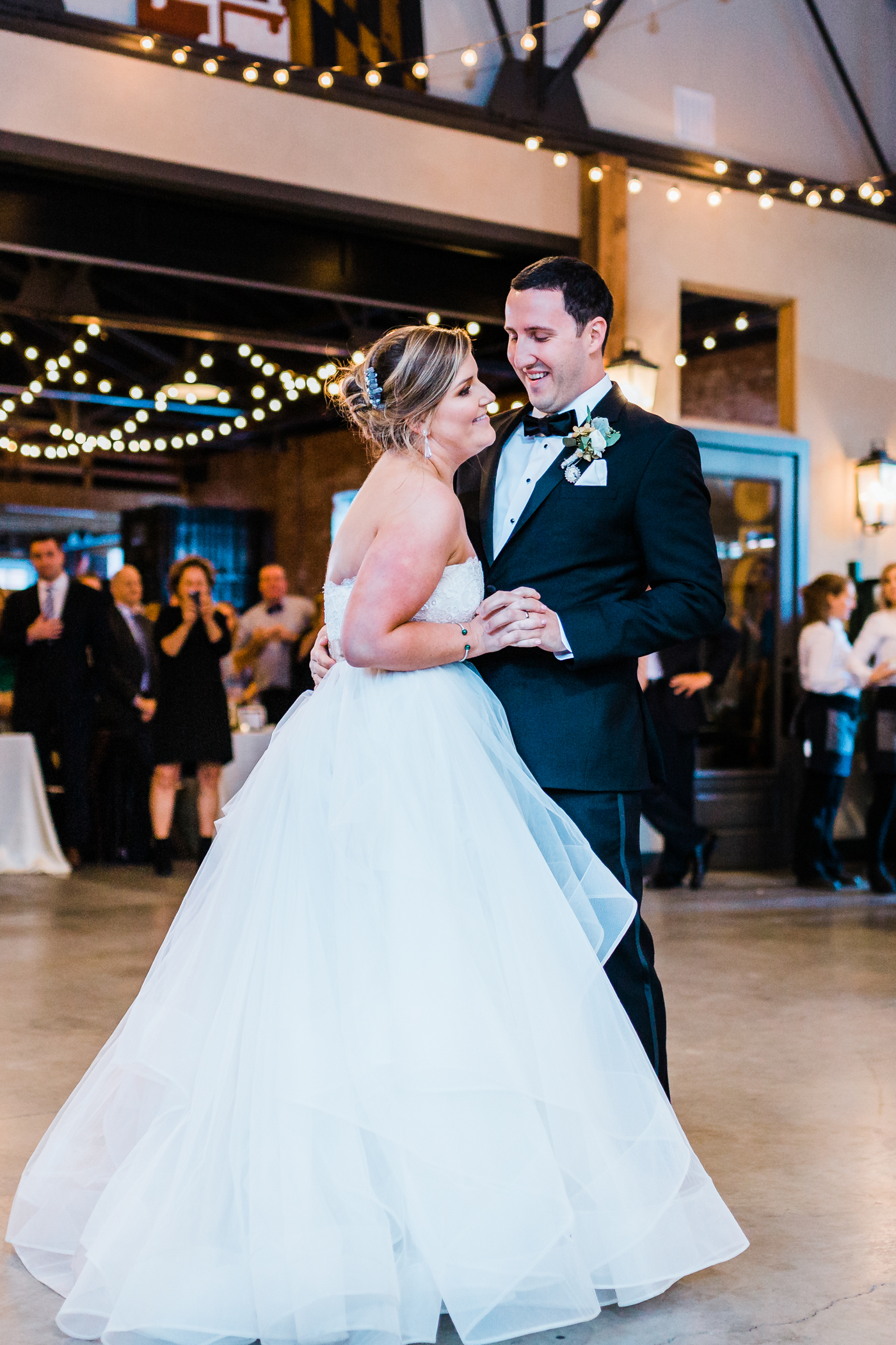 Bride and groom share first dance at reception McClintock distilling - Frederick Maryalnd