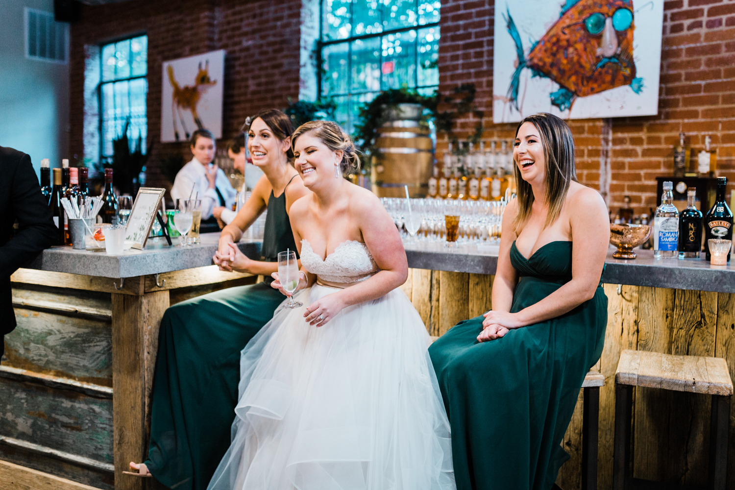 Bride laughing at reception - mcclintock distilling modern venue in Frederick Maryland