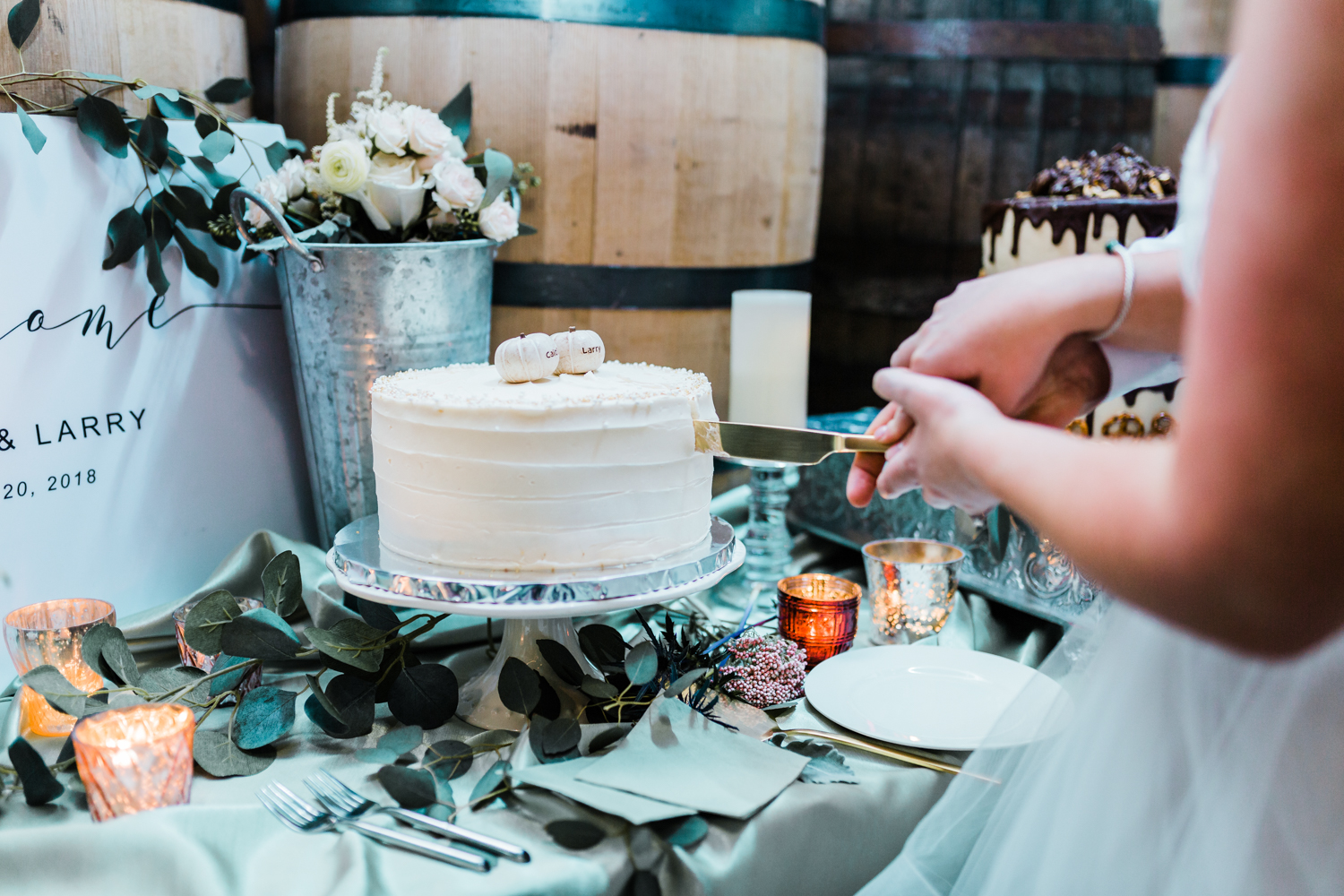 Bride and groom cut wedding cake at McClintock distillery in Frederick Maryland