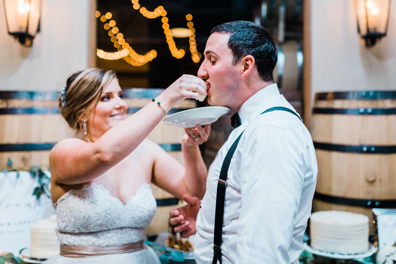 Groom eating wedding cake - best videographer in Maryland