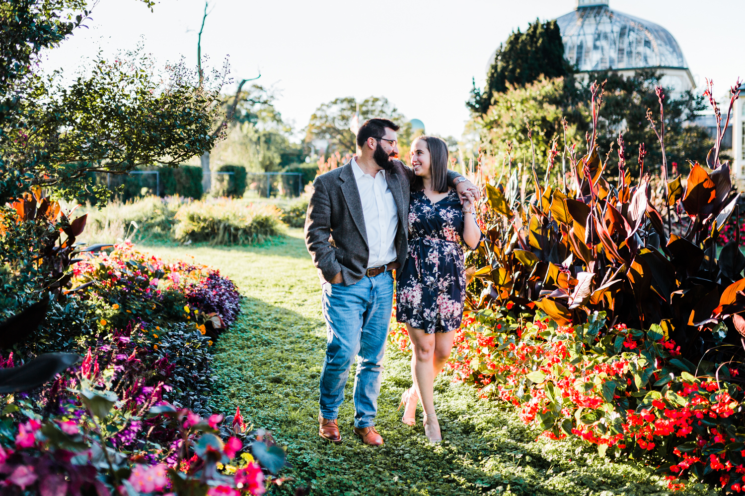 sweet couple walking through garden - top rated engagement photographer in Maryland