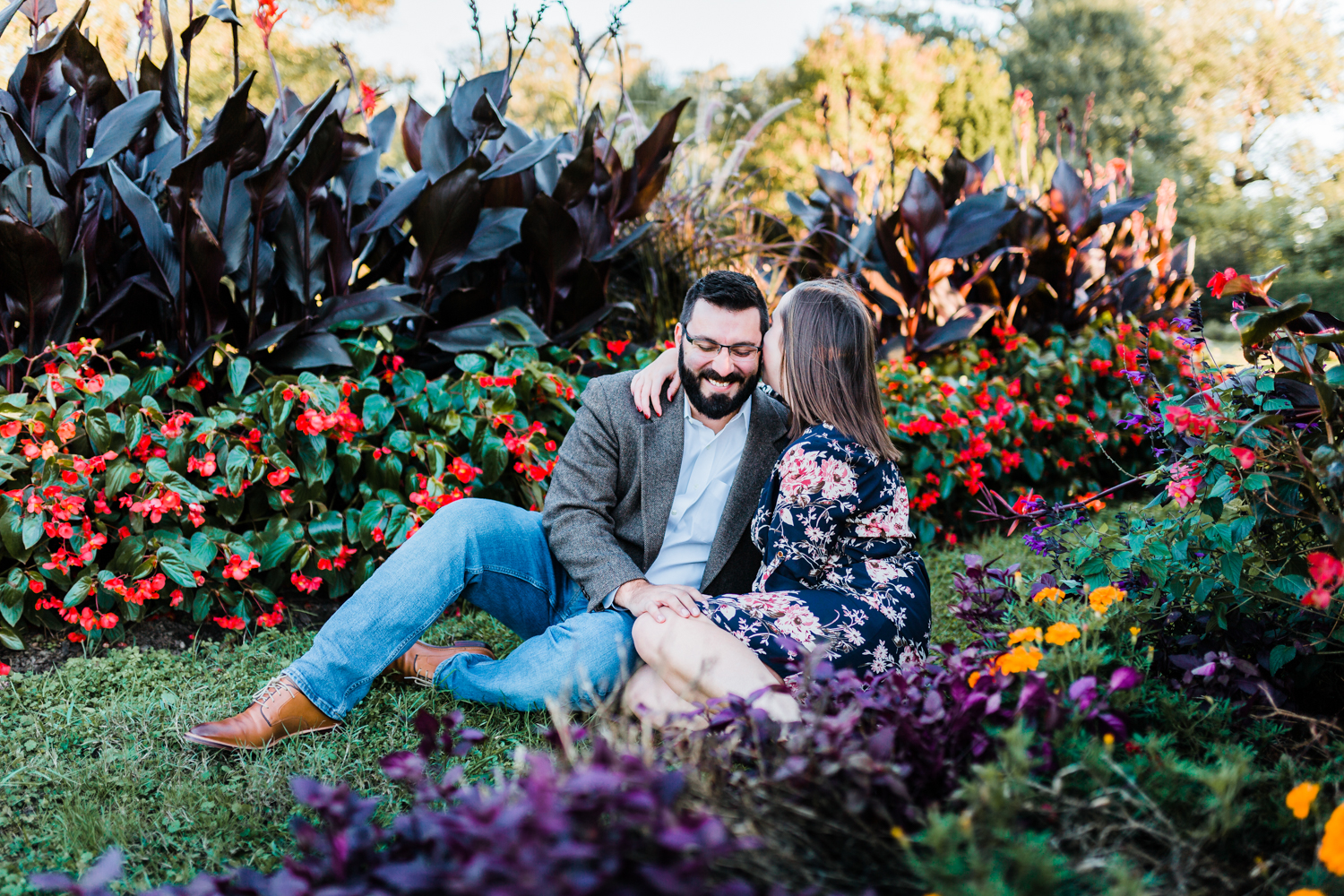 adorable couple sitting in conservatory garden - top candid photographer in Maryland