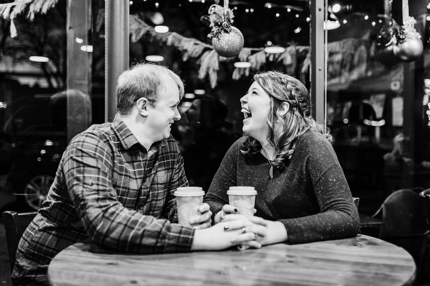 Engagement session couple enjoying coffee at cafe in downtown frederick MD - top rated photographer in Maryland