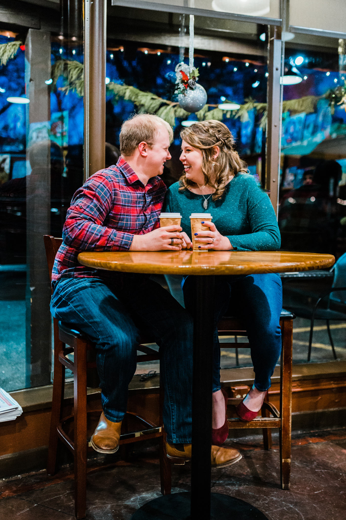 Couple laughing enjoying their coffee at engagement session - best husband and wife photography team in Maryland