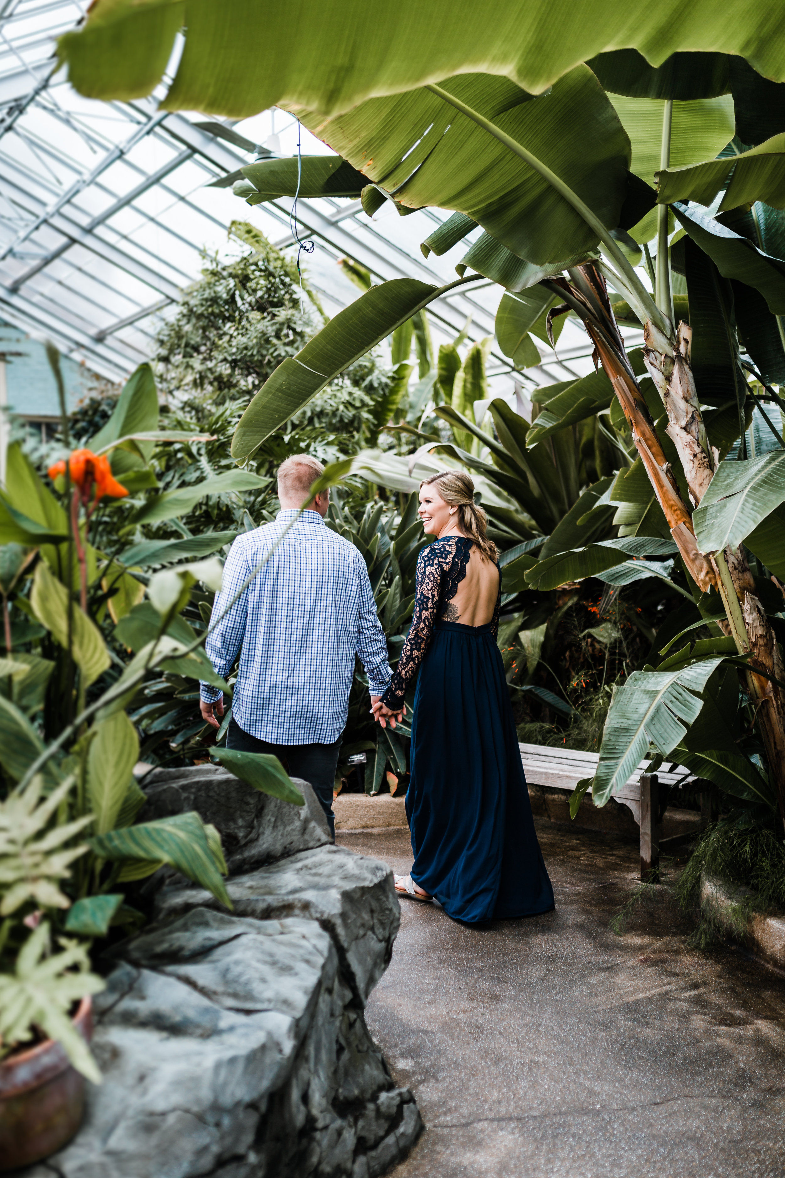 couple walking through conservatory - best photographer in Baltimore, MD