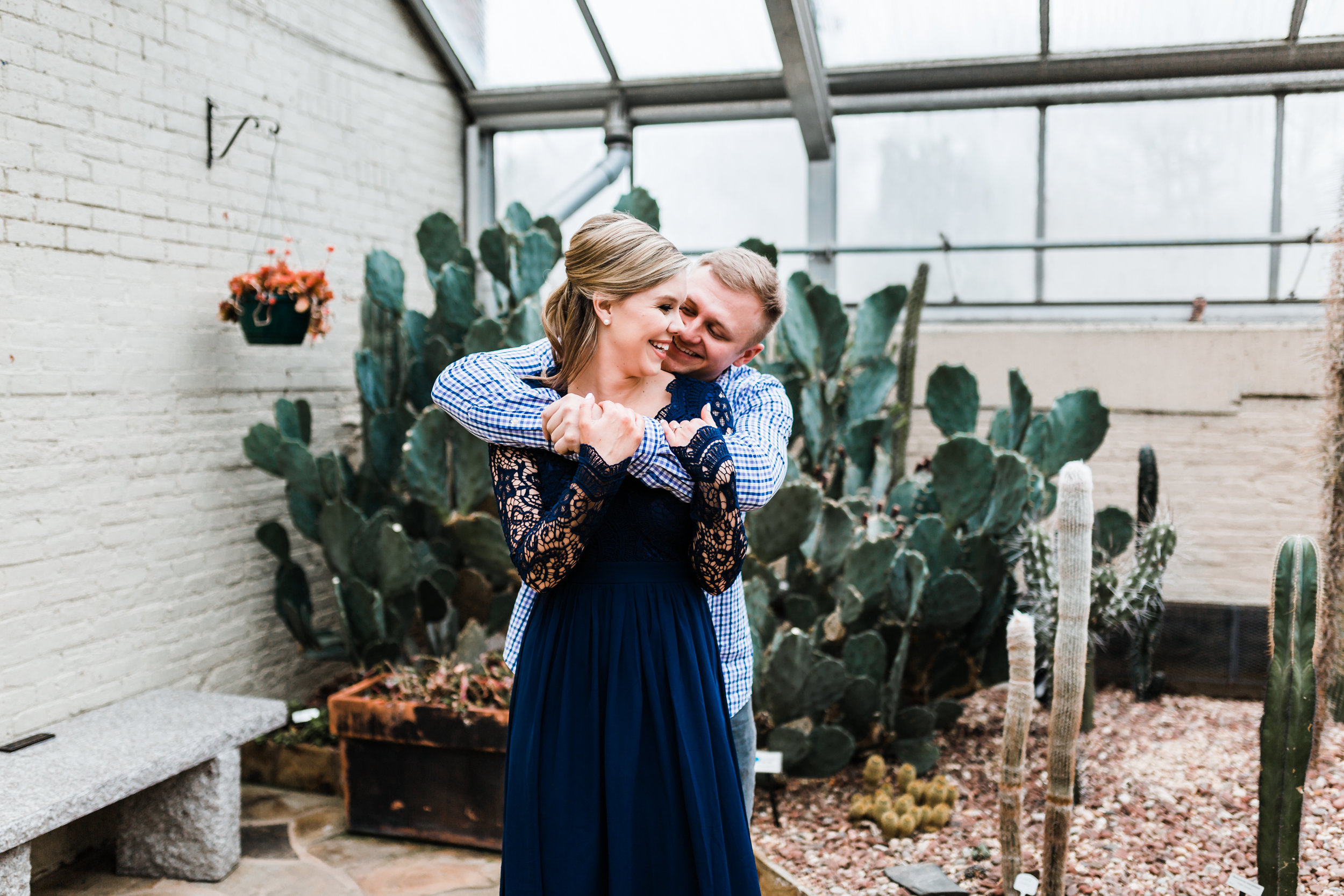 couple laughing in conservatory - best engagement photographer in MD